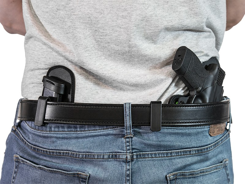 how to reholster a gun