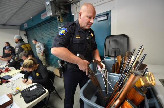 Officers at a gun buyback