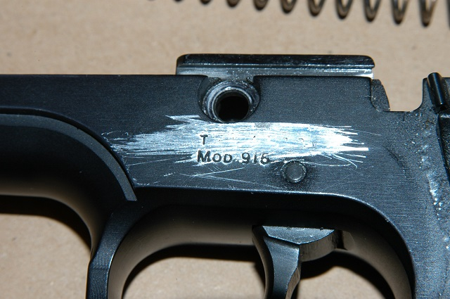 crime gun with scratched off serial number